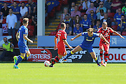AFC Wimbledon defender Paul Robinson (6) is stretched during the EFL Sky Bet League 1 match between Walsall and AFC Wimbledon at the Banks's Stadium, Walsall, England on 6 August 2016. Photo by Stuart Butcher.