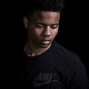 "Markelle Fultz at the North Laurel Community Center ahead of the NBA Draft, in Laurel, MD, on Monday, June 12, 2017. Fultz, 19, a 6'6"" point guard, played one year at the University of Washington and was expected to be the first pick in the NBA draft by the Boston Celtics. He has a quote from Dr. Martin Luther King tattooed on his body that says, ""The ultimate measure of a Man is not where he stands in the moment of comfort and convenience, but where he stands at times of challenge and controversy."" The Celtics traded their pick to the Philadelphia 76ers, who drafted Fultz. Fultz has spent most of his rookie year sidelined by a shoulder injury. For The Boston Globe"