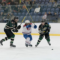 KINGSTON, ON - MAR 9,  2017: Ontario Junior Hockey League, playoff game between the Cobourg Cougars and Kingston Voyageurs, Andrew Suriyuth #27 of the Kingston Voyageurs splits the defence during the 3rd period.<br /> (Photo by Ian Dixon/ OJHL Images)
