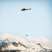 Whistler firefighters do a practice water bucketing drill with Blackcomb Helicopters Wednesday night.  Wednesday, May 17, 2017.   Whistler BC, Canada