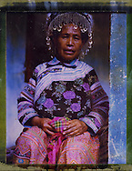 Polaroid 79's portrait of a grand mother wearing tribal clothes.