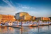 USA, Maryland, Prince Georges County. Sunset light on National Harbor near of Washington, D.C.