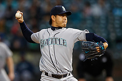 OAKLAND, CA - SEPTEMBER 09:  Hisashi Iwakuma #18 of the Seattle Mariners pitches against the Oakland Athletics during the first inning at the Oakland Coliseum on September 9, 2016 in Oakland, California. (Photo by Jason O. Watson/Getty Images) *** Local Caption *** Hisashi Iwakuma