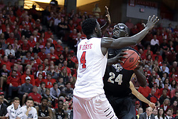 "20 March 2017:  Daouda ""David"" Ndiaye (4) can't stop Tacko Fall during a College NIT (National Invitational Tournament) 2nd round mens basketball game between the UCF (University of Central Florida) Knights and Illinois State Redbirds in  Redbird Arena, Normal IL"
