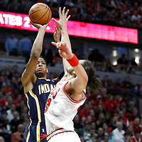 CHICAGO, IL - APR 18: Danny Granger #33 of the Indiana Pacers shoots the ball against Joakim Noah #13 of the Chicago Bulls during game 2 of the Eastern Conference First Round at the United Center on April 18, 2011 in Chicago, IL. NOTE TO USER: User expressly acknowledges and agrees that, by downloading and or using this photograph, User is consenting to the terms and conditions of the Getty Images License Agreement. Mandatory Credit: 2011 NBAE (Photo by Chris Elise/NBAE via Getty Images)