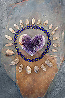 Amethyst Heart circled by Indigo blossoms and quartz crystal. <br />