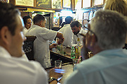 A bartender prepares Mojitos at the popular Habana restaurant La Bodeguita Del Medio.