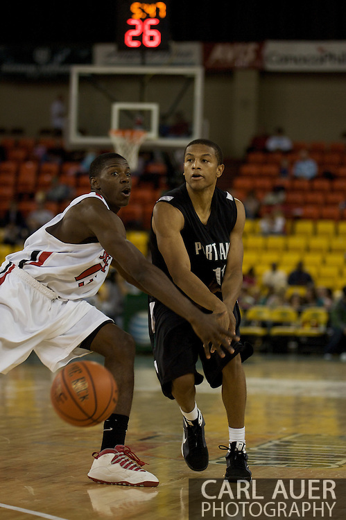November 29th, 2008:  Anchorage, Alaska - Portland State's Dominic Waters (11) slips a pass past Seattle University's Chris Gweth in the third place game on the final day of the Great Alaska Shootout.