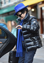 (UK RIGHTS ONLY) Yoko Ono wearing black puffa jacket,  bright blue trilby hat with matching blue jumper and scarf out and about in New York, NYC, USA. 05/03/2013<br />BYLINE MUST READ : EAGLEPRESS/GOTCHA IMAGES<br /><br />Copyright by © Gotcha Images Ltd. All rights reserved.<br />Usage of this image is conditional upon the acceptance <br />of Gotcha Images Ltd, terms and conditions available at<br />www.gotchaimages.com