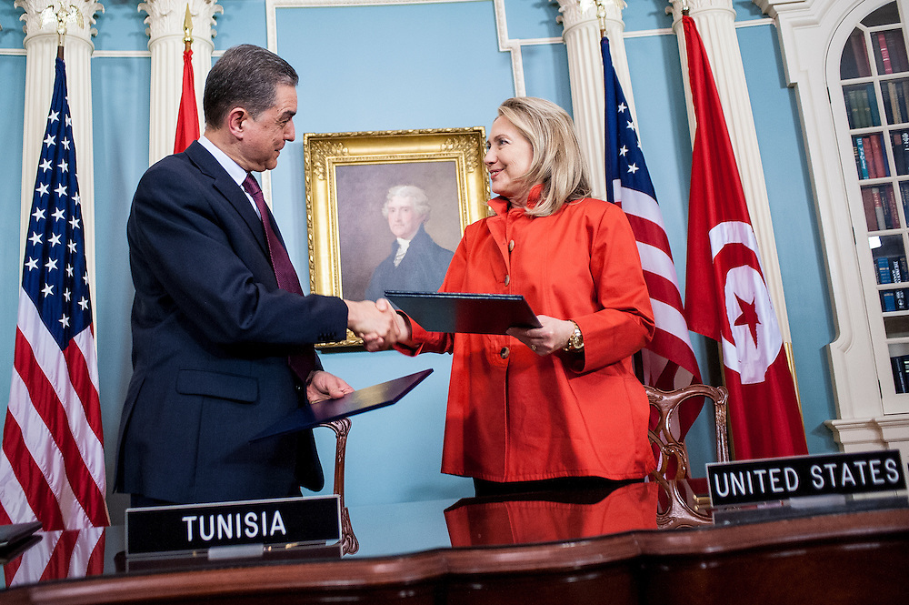 U.S. Secretary of State Hillary Clinton and Tunisian Ambassador to the U.S. Mohamed Salah Tekaya during a signing ceremony at the Department of State in Washington, DC, USA 17 May 2012.