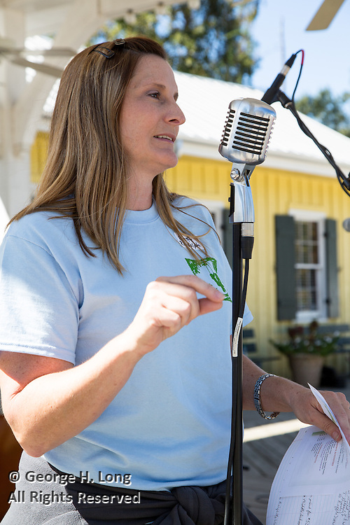 Event organizer Evette Randolph makes announcements at the 2015 Abita Springs Water Festival