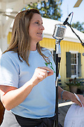 Event organizer Evette Randolph makes announcements at the 2015 Abita Springs Water Festival