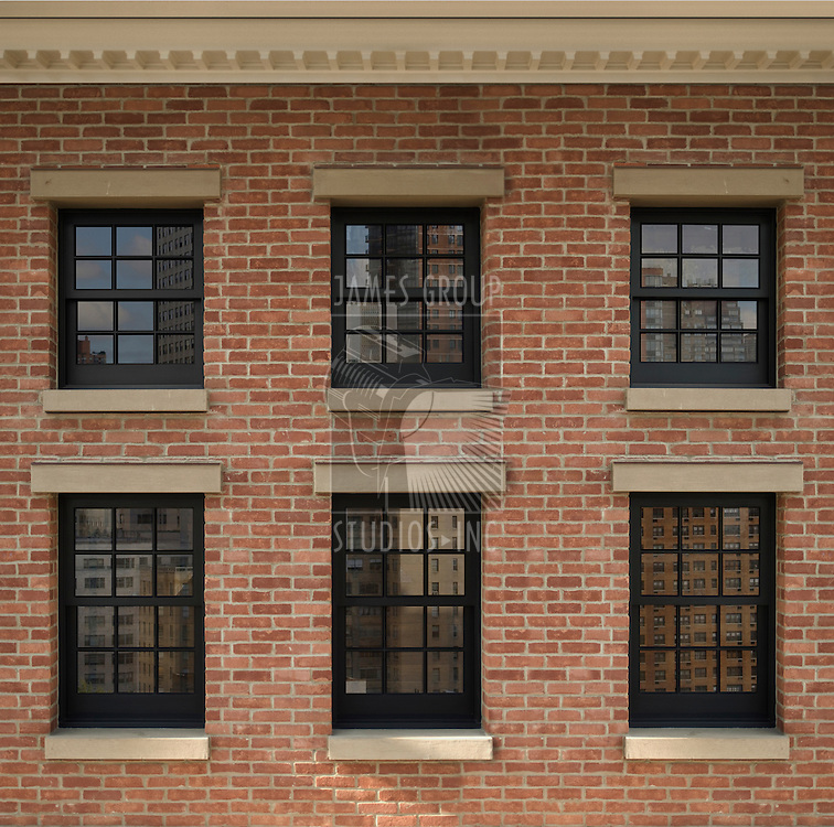 Six windows on the side of a building with clipping path for the panes to insert custom images