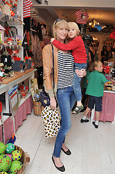 JADE PARFITT and her son JACKSON BURGESS at the opening of the new HoneyJam children's store at 2 Blenheim Crescent, London W11 on 7th July 2011.