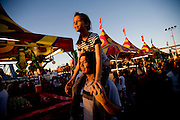 Zina Al-Kaysi, 12, rides on her brother Ahmed's shoulders at the California State Fair on September 3, 2007.