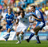 Picture by Ady Kerry/Focus Images Ltd.  .26/09/09.Gillingham's Mark bentley  challenges Norwich's Luke Daley during their Coca-Cola League 1 game at the Priestfield Stadium, Gillingham, Kent.