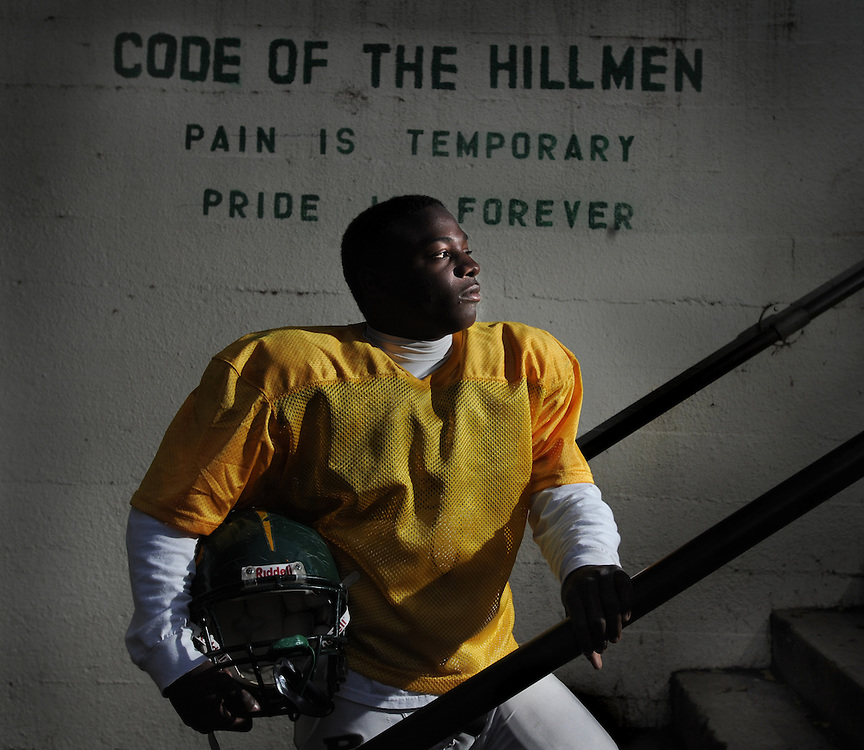 Dalton Dyer of Placer on a stairway that leads to the practice field at Placer High School.