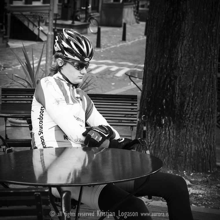 Tired bicyclist resting at a outside cafe in central Amsterdam after a marathon race