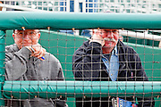 27 FEBUARY 2010 -- GOODYEAR, AZ:  Gary Schultz (CQ) LEFT from Phoenix and Jim Hunter (CQ) from Mesa, watch the Cleveland Indians work out at the new ballpark in Goodyear Saturday.   PHOTO BY JACK KURTZ