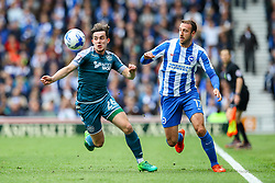 Glenn Murray of Brighton & Hove Albion puts Jamie Hanson of Wigan Athletic under pressure - Mandatory by-line: Jason Brown/JMP - 17/04/2017 - FOOTBALL - Amex Stadium - Brighton, England - Brighton and Hove Albion v Wigan Athletic - Sky Bet Championship