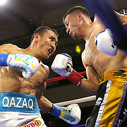 """Kanat """"QazaQ"""" Islam of Almaty, Kazakhstan (L) punches Noroberto """"Demonio"""" Gonzalez of Monterrey, Mexico as he goes on to win the NABO Jr. Middle Weight Title during a Nelsons Promotions boxing match at the Boca Raton Resort  and Club on Friday, May 26, 2017 in Boca Raton, Florida.  (Alex Menendez via AP)"""