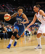 Sep 25, 2011; Phoenix, AZ, USA; Minnesota Lynx guard Seimone Augustus (33) handles against Phoenix Mercury guard Diana Taurasi (3) at the US Airways Center. Mandatory Credit: Jennifer Stewart-US PRESSWIRE