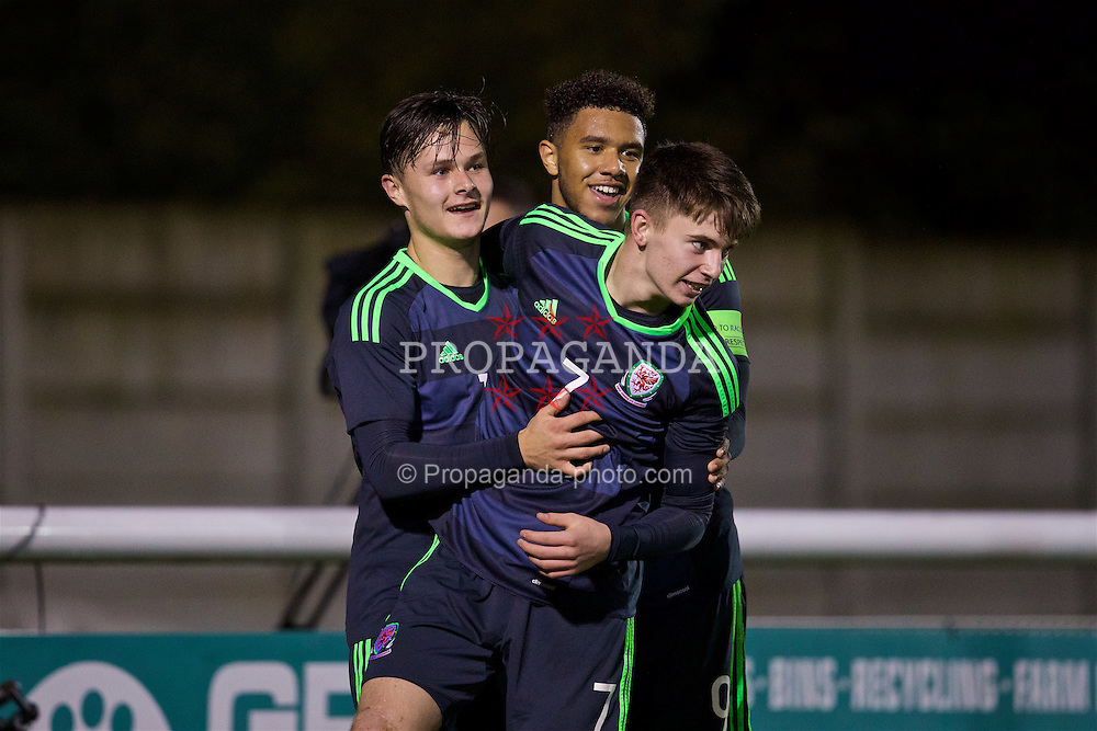 BANGOR, WALES - Tuesday, November 15, 2016: Wales' Liam Cullen celebrates scoring the fourth goal against Luxembourg with team-mates Ben Woodburn and captain Tyler Roberts during the UEFA European Under-19 Championship Qualifying Round Group 6 match at the Nantporth Stadium. (Pic by David Rawcliffe/Propaganda)