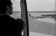 """Scene from the AirTrain at Newark International Airport. US Airways, 737...Part of long-term (2005-2008) story """"I See A Darkness"""". New York, NY."""