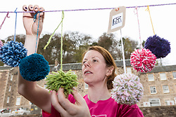 [Insert Detail] during the Scotland-wide World Heritage Day festivities. Six unique events, coordinated by Dig It! 2017, celebrated Scotland's six World Heritage Sites as part of the 2017 Year of History, Heritage and Archaeology. <br /> <br /> Pictured: Event Manager Lindsay McGhie hanging pom-poms