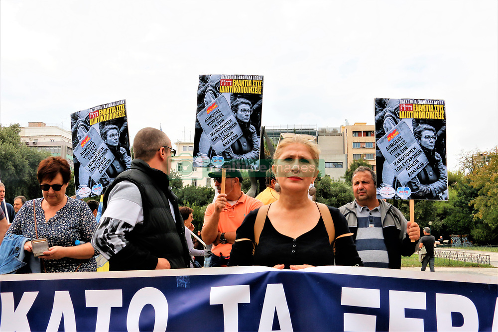 October 3, 2018 - Athens, Greece - Protesters are seen standing holding posters and a banner during the protest..Greek Unions protest demanding better benefits for hazardous occupations. (Credit Image: © Helen Paroglou/SOPA Images via ZUMA Wire)