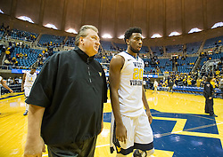 Dec 5, 2015; Morgantown, WV, USA; West Virginia Mountaineers head coach Bob Huggins and forward Brandon Watkins (20) walk off the floor together after their game against the Kennesaw State Owls at WVU Coliseum. Mandatory Credit: Ben Queen-USA TODAY Sports