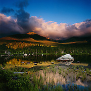 A summer storm rolls over the peaks of  Mt. Katahdin in Baxter State Park, Maine, USA