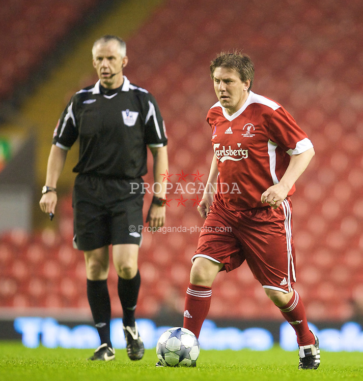 LIVERPOOL, ENGLAND - Thursday, May 14, 2009: Liverpool Legends' Peter Beardsley and referee Chris Foy during the Hillsborough Memorial Charity Game at Anfield. (Photo by David Rawcliffe/Propaganda)