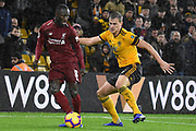 Wolverhampton Wanderers defender Ryan Bennett (5)holds up Liverpool midfielder Naby Keita (8) during the Premier League match between Wolverhampton Wanderers and Liverpool at Molineux, Wolverhampton, England on 21 December 2018.