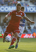 Sean Morrison plays back to the keeper as his only option during the Sky Bet Championship match between Queens Park Rangers and Cardiff City at the Loftus Road Stadium, London, England on 15 August 2015. Photo by Andy Walter.