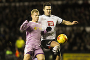 Reading FC forward Matej Vydra and Derby County defender Jason Shackell challenge for the ball during the Sky Bet Championship match between Derby County and Reading at the iPro Stadium, Derby, England on 12 January 2016. Photo by Aaron Lupton.