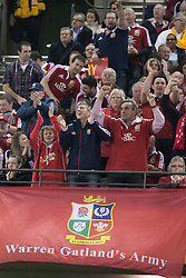 © Licensed to London News Pictures. 29/6/2013. British & Irish Lions fans sitting above a flag reading Warren Gatland's Army  during the British & Irish Lions 2nd test between Qantas Wallabies Vs British & Irish Lions at Etihad Stadium, Melbourne, Australia. Photo credit : Asanka Brendon Ratnayake/LNP