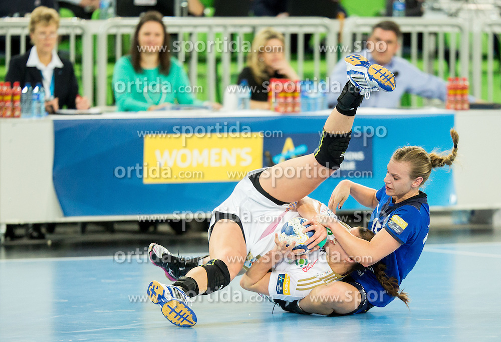 Eduarda Amorim of Gyori and Barbara Lazovic-Varlec #15 of RK Krim Mercator fighting for a ball during handball match between RK Krim Mercator (SLO) and Gyori Audi ETO KC (HUN) in 4th Round of Main Round of  Women's EHF Champions League 2013/14 on March 1, 2014 in Arena Stozice, Ljubljana, Slovenia. Photo by Vid Ponikvar / Sportida