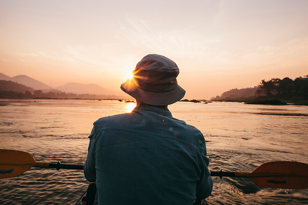 Kayaking to view the sunrise on the Mekong river