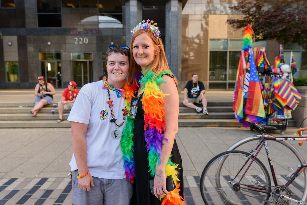 Tonia Heineman and Amanda Kemper.<br /> The Lesbian, Gay, Bisexual, Transgender, and Queer (LGBTQ) community and their friends, family and supporters walked and lined Main Street from Floyd Street to the Belvedere for the Kentuckiana Pride Parade, Saturday, June 16, 2017 in Louisville, Ky. (Photo by Brian Bohannon)