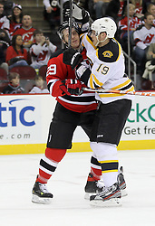 Apr 10; Newark, NJ, USA; Boston Bruins center Tyler Seguin (19)hits New Jersey Devils defenseman Anssi Salmela (29) during the first period of their game at the Prudential Center.