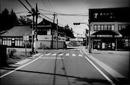 Main central shopping district is shuttered in the veritable ghost town of Kawauchi Village, which sits right on top of the 20 km (12.4 miles) nuclear no-entry zone line.  Less than two weeks ago, half of the village was within the exclusion zone but the police check point has been moved back to the edge of the village.  It still sits within the 30 km (18.6 miles) voluntary evacuation zone where residents are encouraged to stay indoors and be ready for immediate evacuation if necessary.  Important crossroads between Koriyama in the main central valley and Iwaki a seaside harbor town, pass through this isolated mountain village.  Some villagers have begun to return but the village remains a ghost town.   Fukushima Prefecture, Japan.