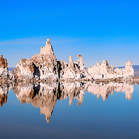 Tufas in south Mono Lake Preserve reflect in perfectly calm waters. Lee Vining, California