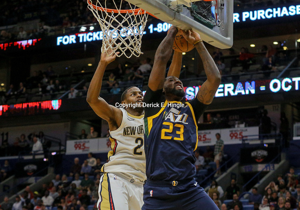 Mar 11, 2018; New Orleans, LA, USA; Utah Jazz forward Royce O'Neale (23) is blocked by New Orleans Pelicans forward Darius Miller (21) during the second half at the Smoothie King Center. Mandatory Credit: Derick E. Hingle-USA TODAY Sports