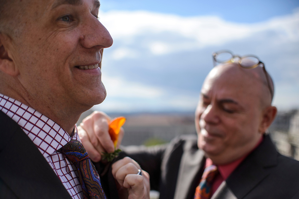 Photo by Matt Roth<br /> Assignment ID: 30148071A<br /> <br /> David Hagedorn, right, a chef and food writer, fastens a boutonniere onto his groom Michael Widomski, a spokesman for the National Weather Service, moments before the two were married by Justice Ruth Bader Ginsburg on the rooftop of the Fiola Restaurant in Washington, DC, Sunday, September 22, 2013