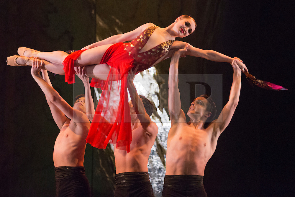 "© Licensed to London News Pictures. 01/04/2014. London, England. Pictured: Firebird, choreographed by George Williamson, Kensia Osayanick as Firebird. Dress rehearsal of the English National Ballet's programme ""Lest We Forget"" with dance inspired by the centenary of the Great War, Barbican Theatre, London. Award-winning British contemporary choreographers Akram Khan, Russell Maliphant and classical ballet choreographer Liam Scarlett have each been commissioned to create new work to reflect the moving and powerful impact of the First World War on those setting off to fight and those left behind. The programme is completed by George Williamson's re-worked Firebird. 2 - 12 April 2014. Photo credit: Bettina Strenske/LNP"