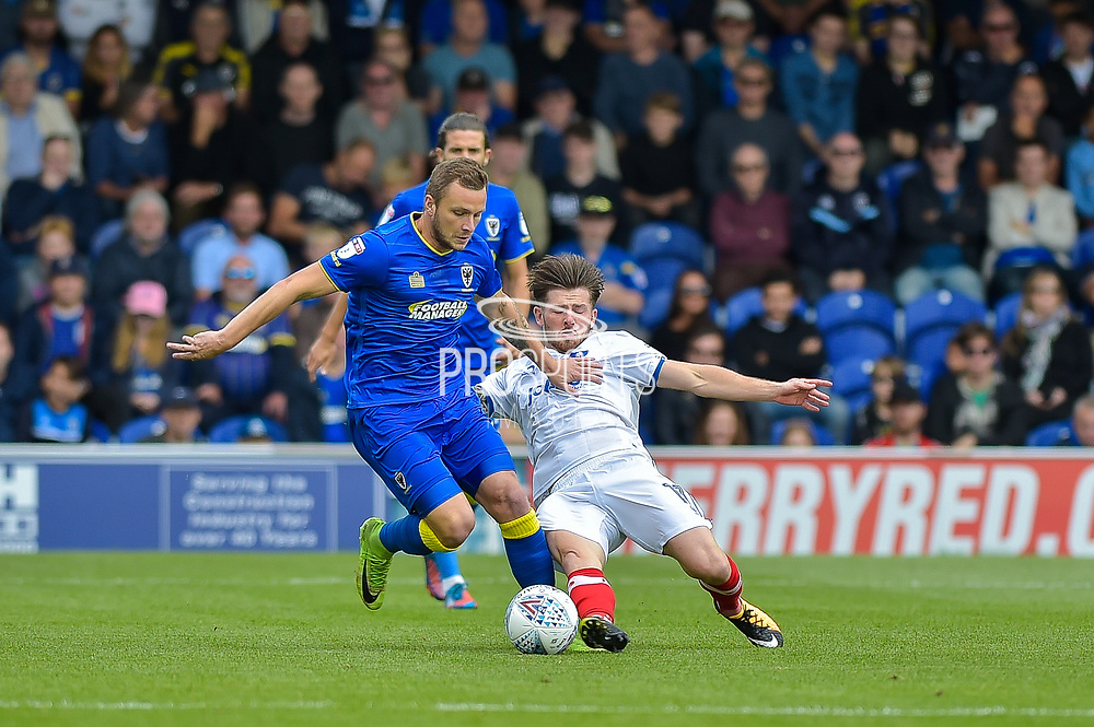 AFC Wimbledon Midfielder, Dean Parrett (18) and Portsmouth Midfielder, Matty Kennedy (11) during the EFL Sky Bet League 1 match between AFC Wimbledon and Portsmouth at the Cherry Red Records Stadium, Kingston, England on 9 September 2017. Photo by Adam Rivers.