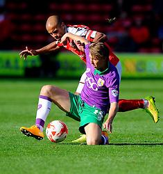 Bristol City's Luke Freeman battles for the ball with Walsall's Adam Chambers  - Photo mandatory by-line: Joe Meredith/JMP - Mobile: 07966 386802 - 04/10/2014 - SPORT - Football - Walsall - Bescot Stadium - Walsall v Bristol City - Sky Bet League One
