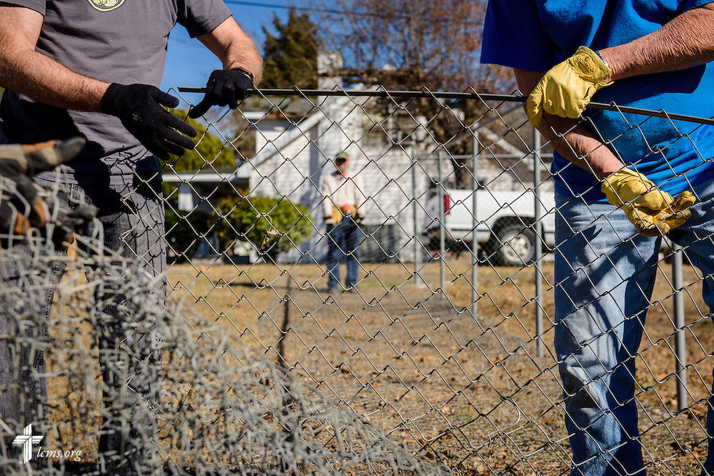 Volunteers from Hope Lutheran Church in Wake Forest, N.C., rebuild a fence at Nanny's Korner Care Center on Thursday, Jan. 19, 2017, in Lumberton, N.C. The center was damaged in October from flooding related to Hurricane Matthew. LCMS Communications/Erik M. Lunsford