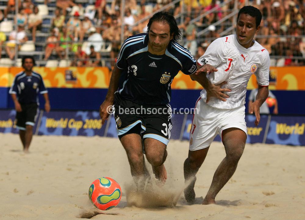 Football-FIFA Beach Soccer World Cup 2006 - Group D-Bahrain - Argentina, Beachsoccer World Cup 2006. Argentina's Casado and Bahrain's Ebrahim - Rio de Janeiro - Brazil 04/11/2006<br /> Mandatory credit: FIFA/ Manuel Queimadelos